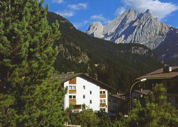 Apartment in Canazei. Where we are - how to reach us  Our apartments are located in the center of Canazei – Val di Fassa Walking few steps from Cesa Maria you can reach easily all shops and services of primary importance. Cesa Maria apartments are about 600 metres from the cable car station in Canazei far away and 2 minutes walking distance from the stop bus, from where you can catch the free ski bus to reach the ski lifts of Canazei, Campitello, or Alba.  In just two minutes, you'll get to the town park and to the start point of numerous trails for walking. See the map to reach us