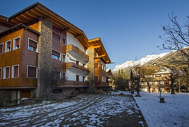 Apartment in Moena. Villa Ginestra is located 600 mt from the centre of the village, in a quite place. Garden and parking. Skiroom. The apartments are provided with tv color SAT, washmachine and hair-dryer.