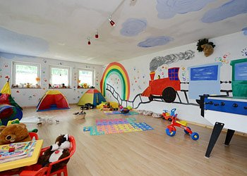 Apartment in Canazei. Playing room for children.