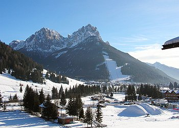 Residences in San Giovanni di Fassa - Pera. Panoramic sight from the house of the Sasso delle Undici (2,501 m s.l.m.) and Sasso delle Dodici (2,446 m s.l.m.) with the track illuminated