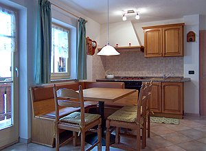 Apartment in San Giovanni di Fassa -  Muncion. The apartments have 3 bed-rooms, living room with kitchen and bed-settee, 2 bathrooms with dish-washer, TV.