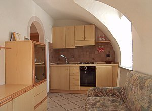 Apartment in Soraga. The kitchen is endowed with an electric oven, a gas-stove, a refrigerator, a wash-basin, besides a traditional kitchen-equipment