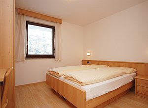 Apartment in Soraga. The bed-rooms with one double bed and two single beds.