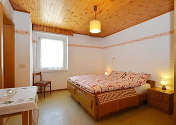 Apartment in Canazei. 1st. Bedroom with doublebed and bathroom