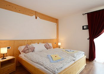 Apartment in Canazei. Room name SELLA for 2 person,badroom,balcony,television.