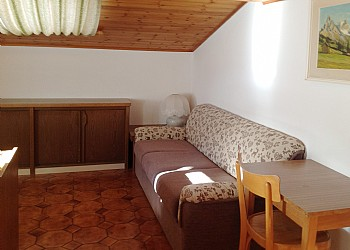 Apartment in Soraga. Attic flat, situated on the top floor, 70 square meters, consists of two bedrooms, two bathrooms, large living room with dining area and kitchen area. It has a typical mountain style warm and welcoming, very relaxing.