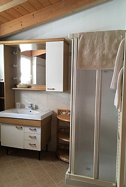 Apartment in Canazei. big bathroom with basin, WC, bidet, shower and window